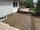 Stone patio between wood decks